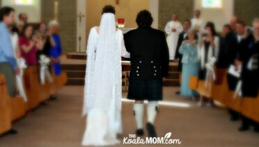 Bride and groom walking down the aisle together on their wedding day.