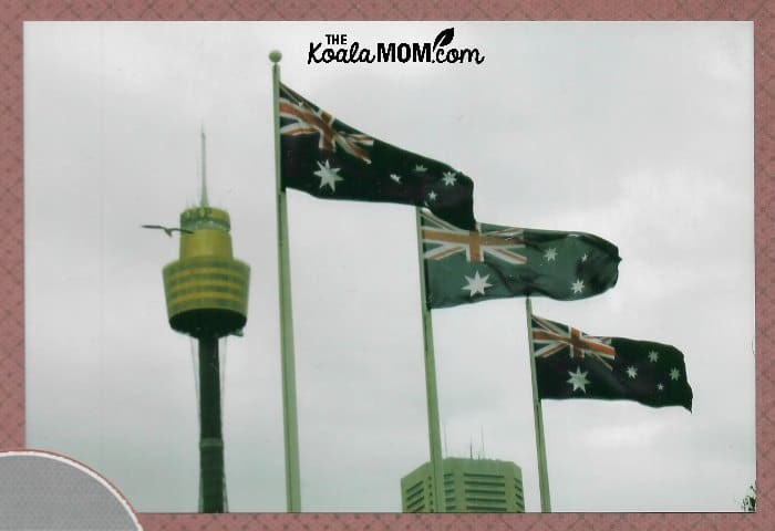 Australian flags flying in front of the Sydney Tower.