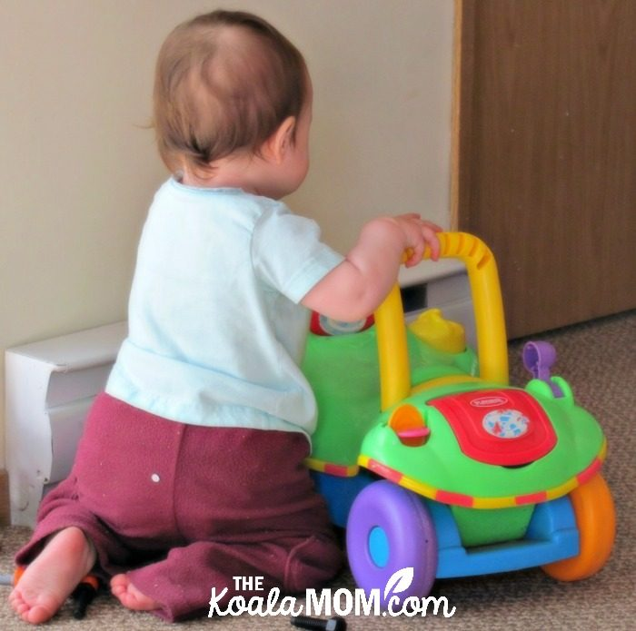 Baby milestones: learning to crawl with the help of a toy