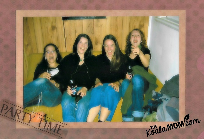 Four girls in black tops and jeans partying with green apple wine
