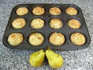 picture of muffin tray with pear cardamon muffins