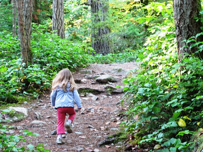 Toddler hiking the trestle trail at Goldstream Park