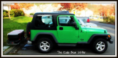 Our bright green Jeep TJ with a hitch and basket on the back