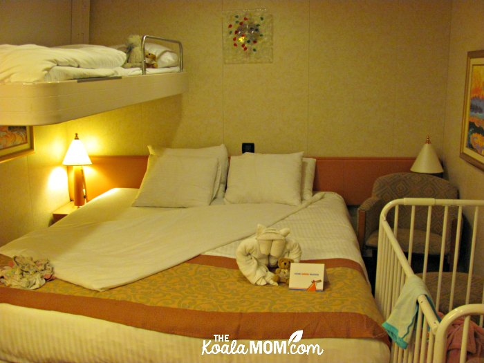 Interior room on the Carnival Splendor, with a fold-down bunkbed and a crib.