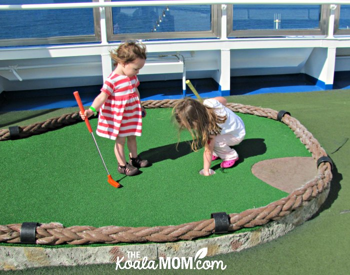 Sunshine and Lily playing mini golf on the Carnival Splendor.