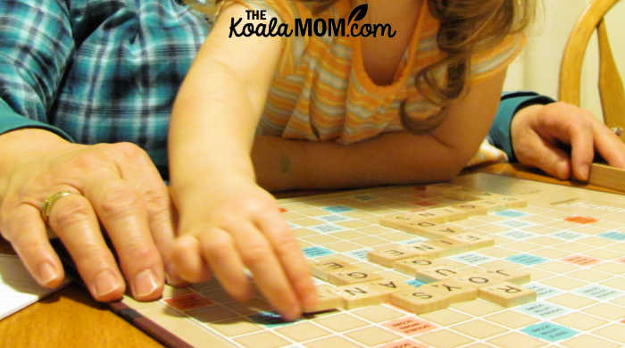 3-year-old Sunshine helps Grandma play Scrabble, because board games with preschoolers is fun!