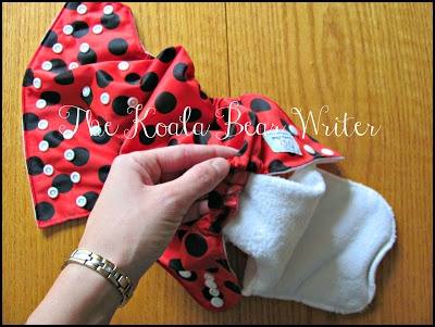 "Kawartha Cloth diapers are affordable Canadian pocket diapers that come in cute colours, like the ""ladybug diaper"" shown here with the microfiber insert."