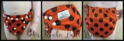 "Kawartha Cloth diapers are affordable Canadian pocket diapers that come in cute colours, like the ""ladybug diaper"" modeled by my toddler here."
