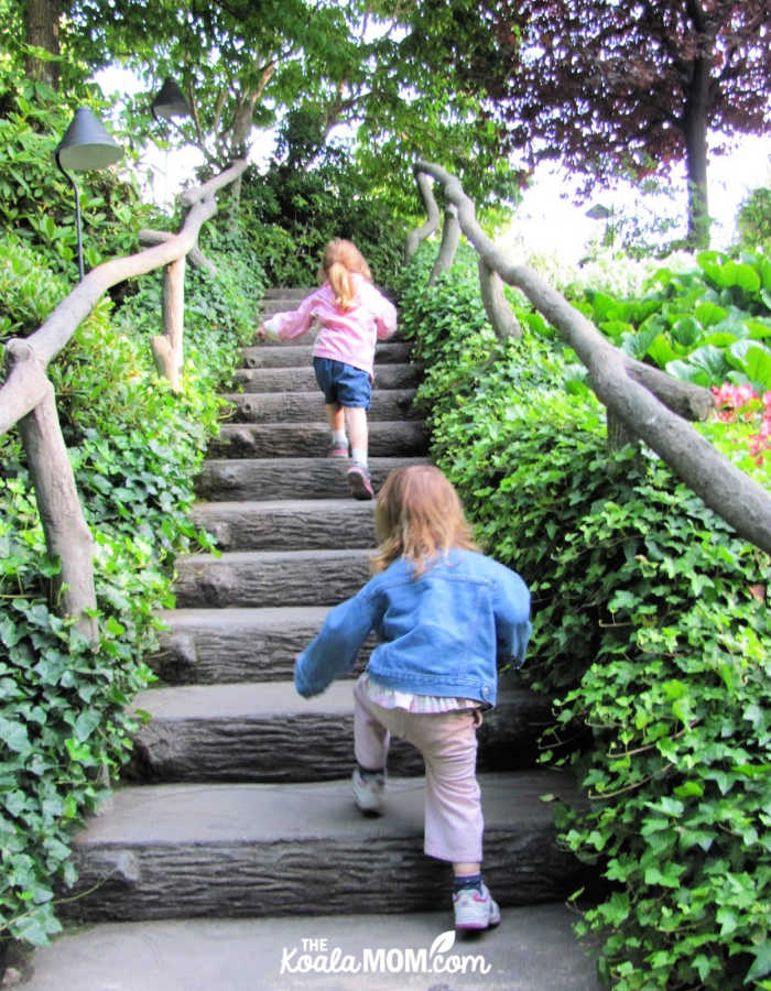 Sisters climbing the stairs to explore the garden.