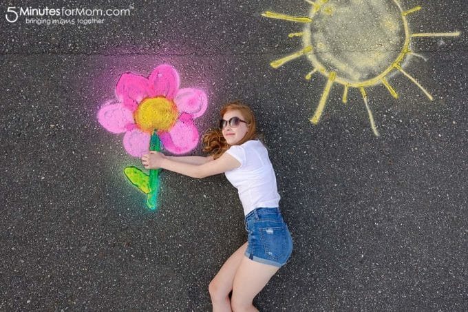 Girl holding flower in spray chalk photography. (Photo credit: 5 Minutes for Mom)