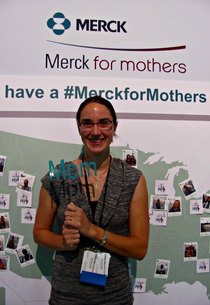 Bonnie Way posing at the Merck booth at BlogHer14
