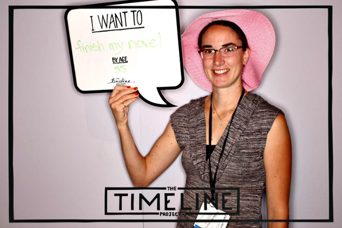 Bonnie Way posing at the TimeLine Project booth at BlogHer14 conference