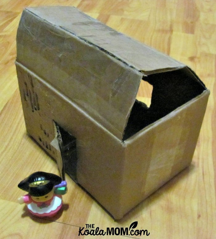 Small cardboard box house for Little People or dolls.