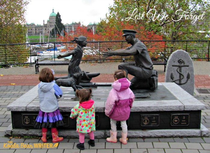Children at a Navy memorial - Lest we forget