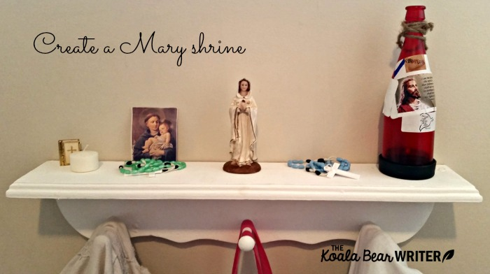 Sunshine's Mary shrine includes a statue of Mary, a candle, rosaries, and a prayer card.