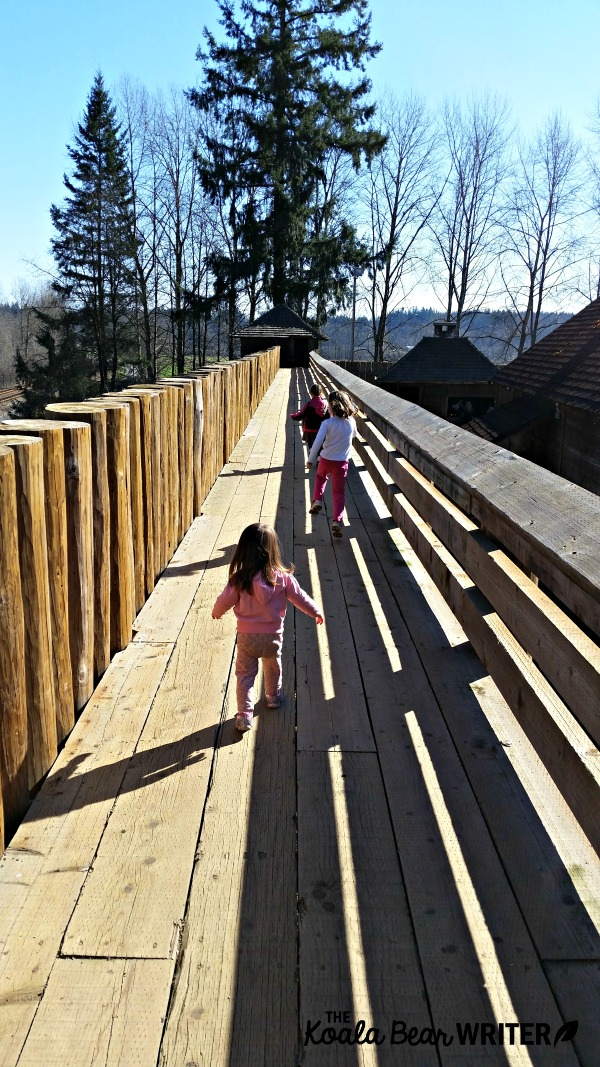 Girls running along the walls at Fort Langley National Historic Site, BC
