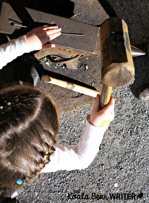 Sunshine tries to be a blacksmith at Fort Langley National Historic Site, BC