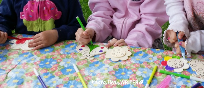 Colouring wood magnets.