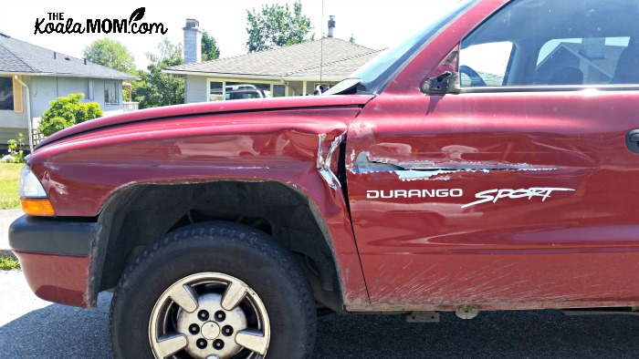 Red Dodge Durango Sport after accident