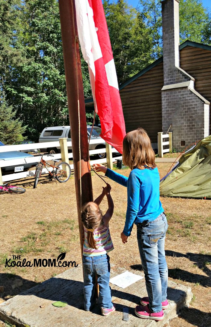 Jade helps raise the flag at homeschool camp