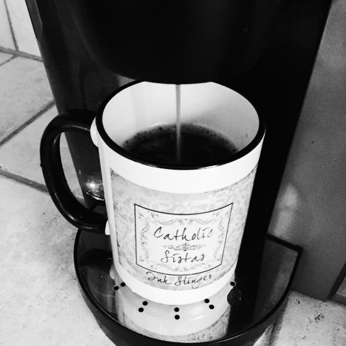 Catholic Sistas coffee mug being filled with fresh coffee