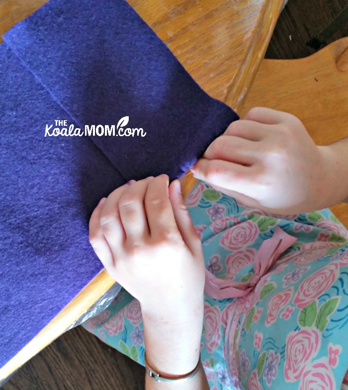 Sunshine sewing her felt notebook case