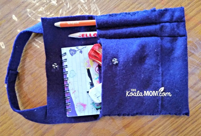 Felt notebook case with notebook, pencils, eraser and pencil sharpener