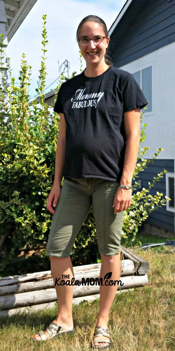 Pregnant mom wearing a baggy T-shirt and capris