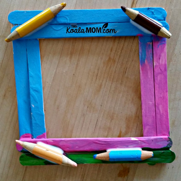 Craft stick picture frame, painted and decorated with pencil crayons