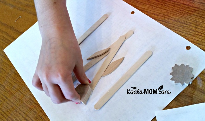 Lily gluing plant markers together
