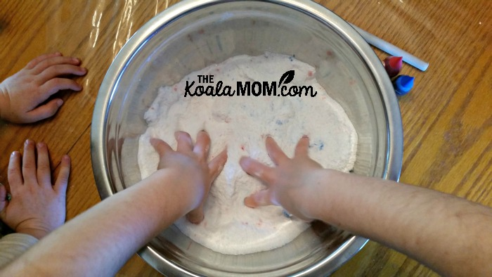 Kids mixing bath salts with their hands