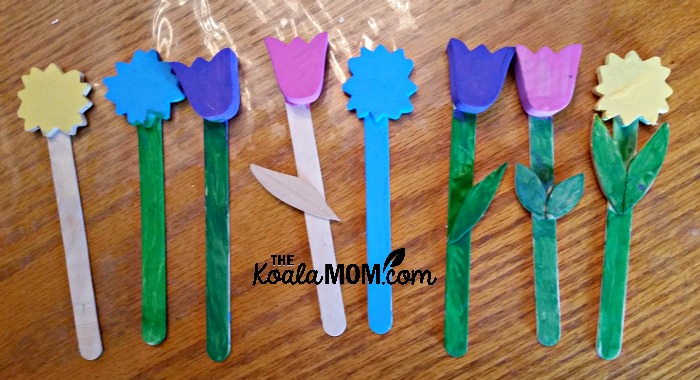 Painted plant markers, made from craft sticks and wood flower cutouts