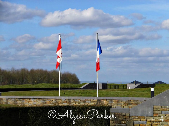 Canadian and French flag at the war memorial