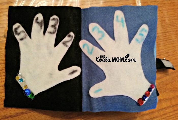 Quiet Book: child's hands, with sequin bracelets and numbered fingers