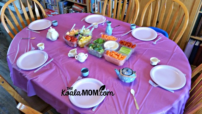 Table set for a purple birthday tea party