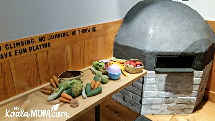 Kids' wood-burning oven and toy food at Rocky Mountain Flatbread
