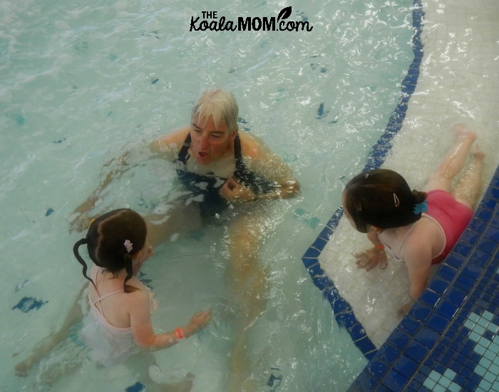 Swim teacher at the pool with girls