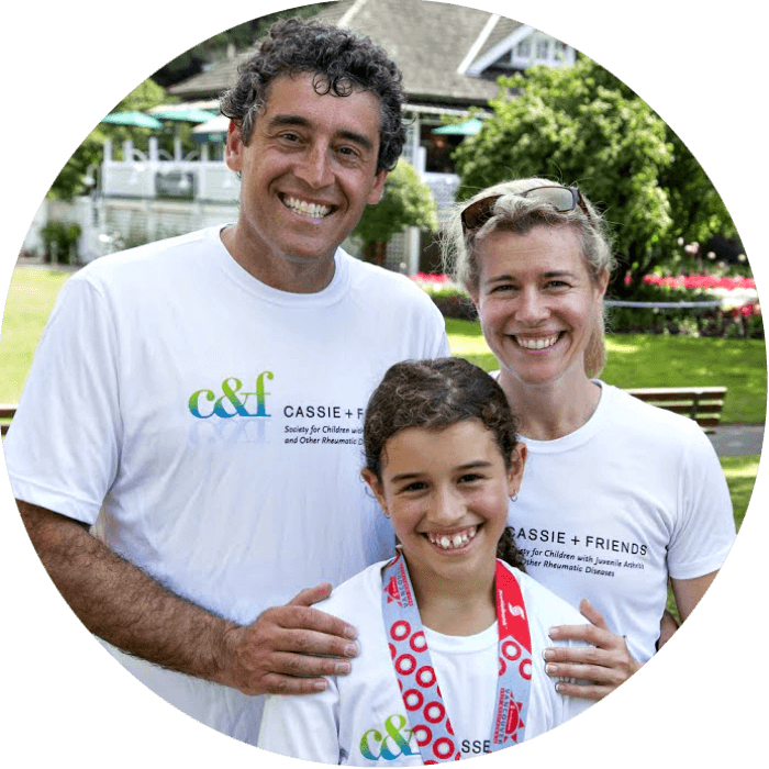 Cassie Porte with her parents, running to raise money for juvenile arthritis