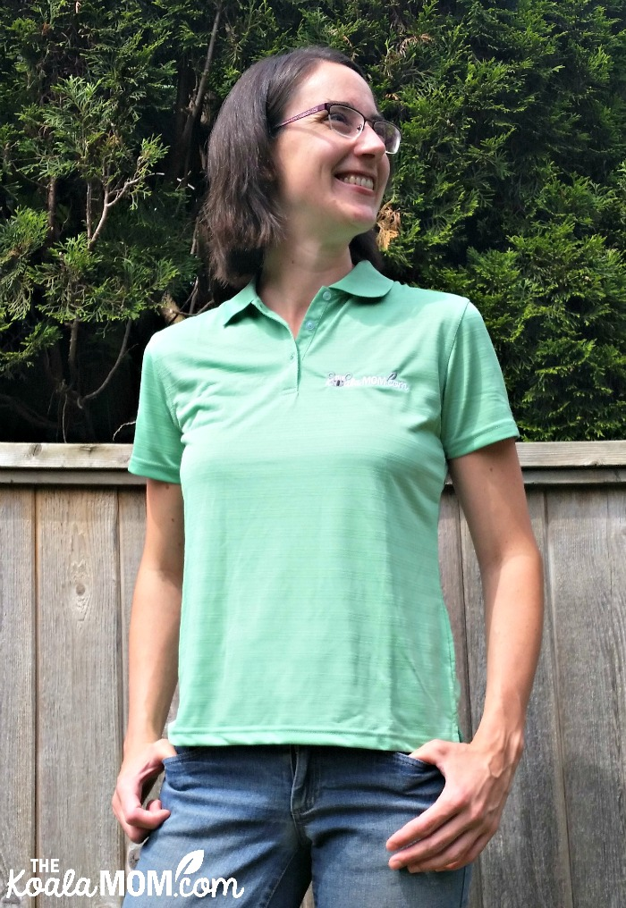 Bonnie Way wearing a green polo with the Koala Mom logo on it from Bravo Apparel