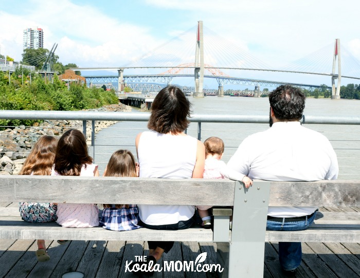 Way family sitting on a bench at New Westminster Pier Parkphoto by Memotime Photography
