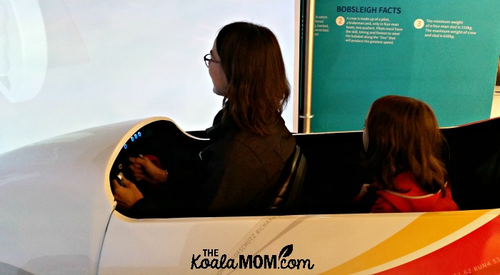 Riding the boblsleigh simulator at the Richmond Olympic Experience with our Kidsworld passes