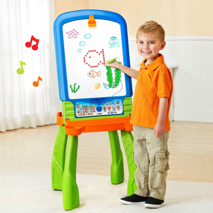 Boy drawing at a DigiArt Creative Easel, one of the VTech toys on my Christmas gift guide