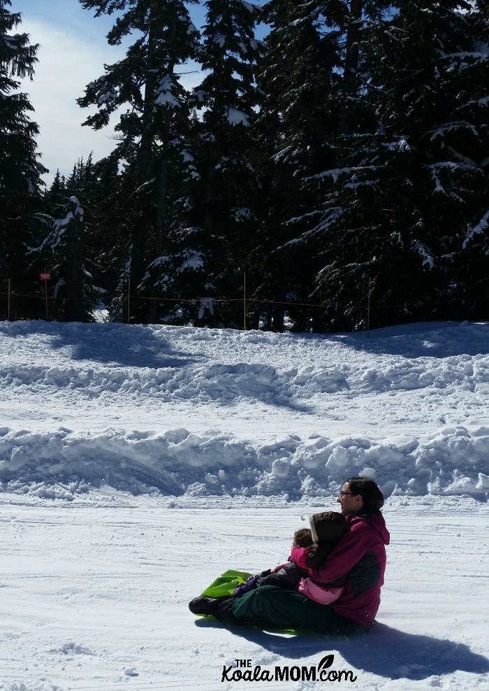 Bonnie Way riding a crazy carpet at Mount Seymour with her youngest two daughters