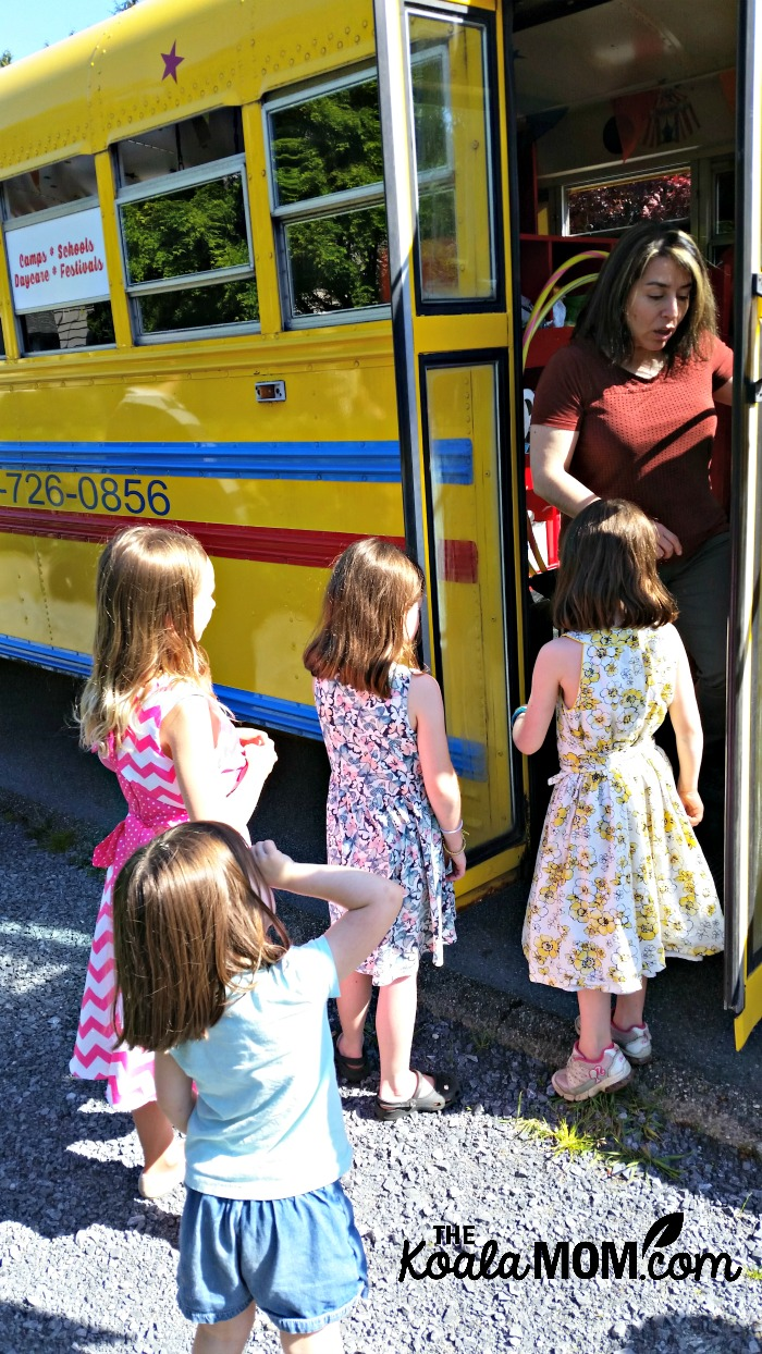 All aboard the Vancouver Tumblebus! Children at a GymBus birthday party line up to play on the bus.