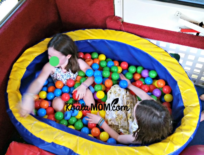 Sunshine and Lily in the ball pit at a Fun GymBus birthday party