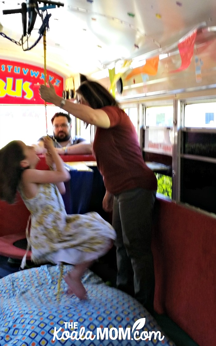 Lily swinging on the Tumblebus