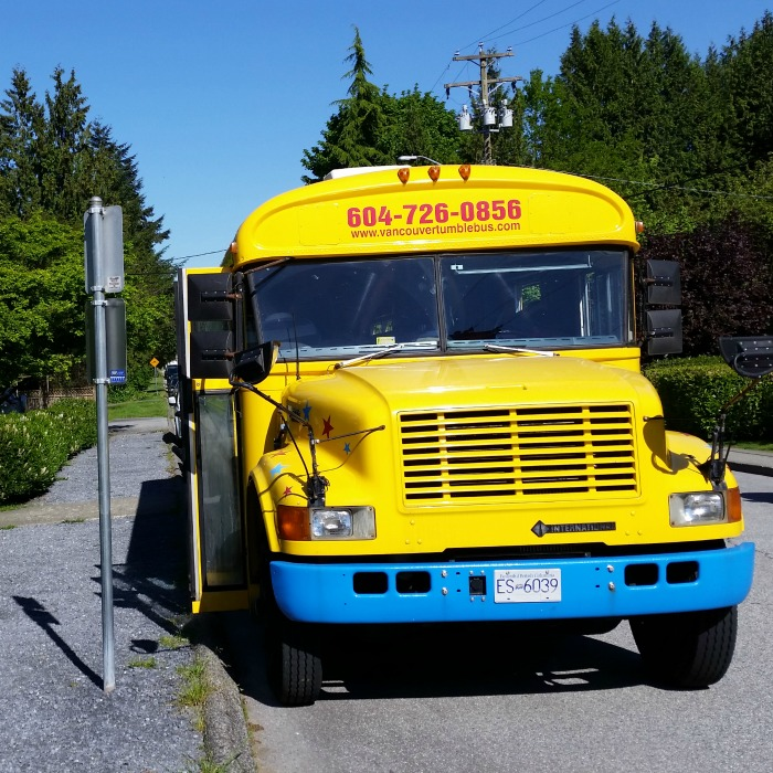 Vancouver Fun GymBus parked on the street while kids play inside