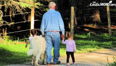 Girls walking the dog with Grandpa.