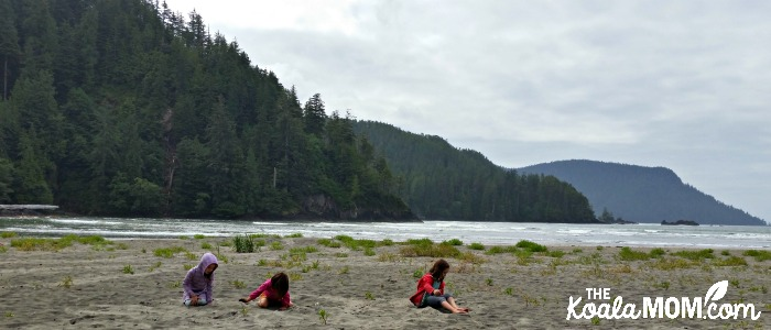 Girls playing in the sand at San Josef Bay in Cape Scott Provincial Park