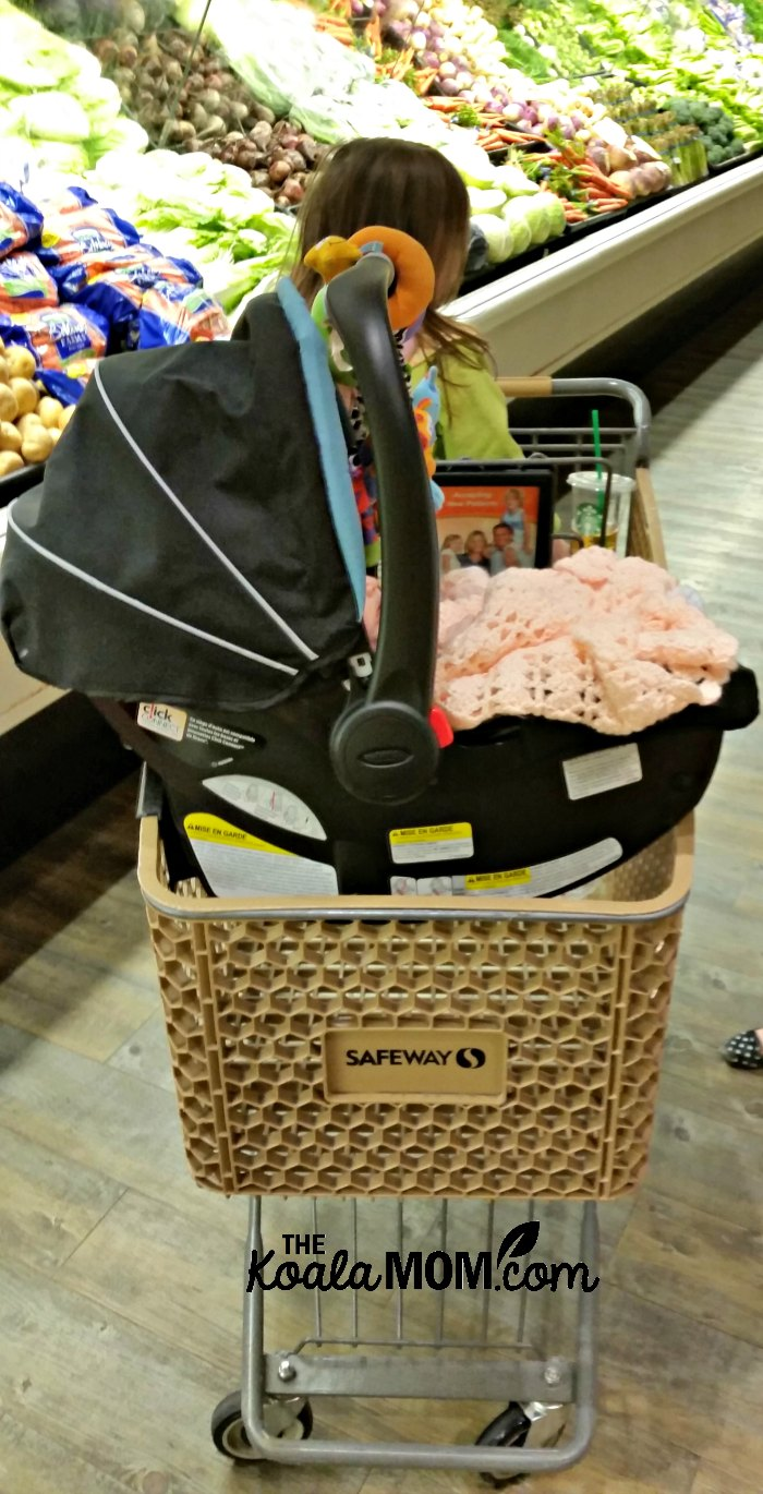 Baby car seat on a grocery cart